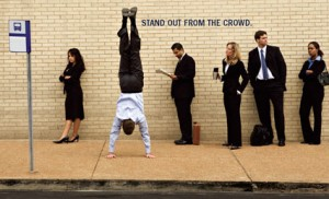 Stand out from the crowd illustration with man doing hand stand | A to Z Discount Printing